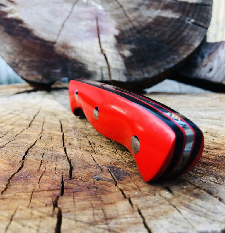 Nomad G10 Red Scales with Red and Black liners